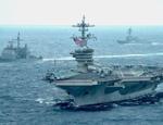 美航母战斗群进入南海,解放军13架飞机7次抵近